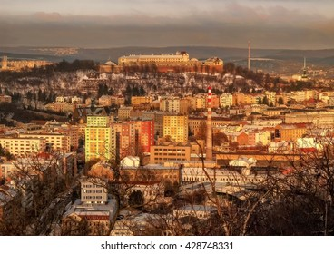 Castle Spilberk and the old Brno in the winter with snow dusting, view from the district Kamenka in the late afternoon sun