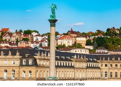 Castle square in Stuttgart, Germany with monument in the foreground and residential area in the background