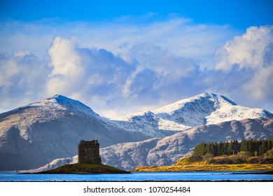 Castle Stalker, the 14th century fortress on a small island at Loch Linnhe with Creach Bhein summit on background in Argyll, Scotland.
