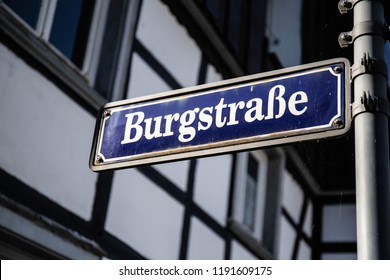 A castle street blue and white street sign in a old german town