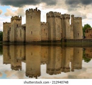 Castle surrounded by a moat with a reflection