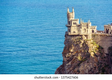 Castle of Swallow's Nest in Black Sea, Crimea, Russia. It is a famous tourist attraction of Crimea. Scenic panorama of the Crimea landmark in summer. Amazing view of Swallow's Nest on the rock top.