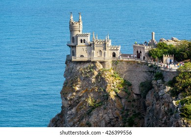 Castle of Swallow's Nest in Black Sea, Crimea, Russia. It is one of the top landmarks of Crimea. Amazing view of Swallow's Nest on a cliff at the precipice. Scenic beautiful coast of Crimea in summer.