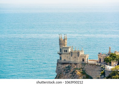 Castle of Swallow's Nest on a cliff over the Black Sea, Crimea, Russia. Famous Crimea landmark. Swallow's Nest is a symbol of Crimea. Aerial panoramic view of the Crimea coast with seascape in summer.