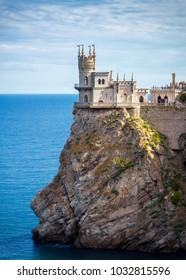 Castle of Swallow's Nest on the rock in Crimea, Russia. It is a symbol and landmark of Crimea. Scenic view of the sea coast with Swallow's Nest above abyss. Amazing historical architecture of Crimea.