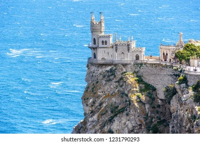 Castle Swallow's Nest on a rock at Black Sea, Crimea, Russia. It is a famous tourist attraction of Crimea. Amazing view of the Crimea landmark in summer. Architecture and nature of southern Crimea.
