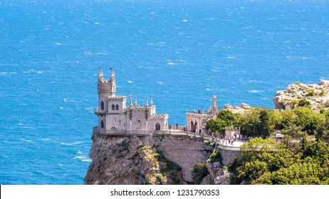 Castle Swallow's Nest on a rock at Black Sea, Crimea, Russia. It is a famous tourist attraction of Crimea. Panoramic view of the Crimea landmark in summer. Architecture and nature of southern Crimea.