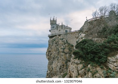 Castle Swallow's Nest on a rock at Black Sea, Crimea, Russia. It is a symbol and tourist attraction of Crimea. Scenic panoramic view of the Crimea southern coast. Architecture and nature of Crimea.