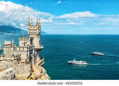 Castle Swallow's Nest on the rock in the Black Sea, Crimea, Russia. It is one of the main travel destinations of Crimea. Scenic panoramic view of the Crimea coast with Swallow's Nest above abyss.