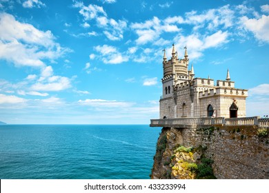 Castle Swallow's Nest on the rock in Black Sea, Crimea, Russia. Amazing panoramic view of castle at the precipice. Seascape in Crimea with castle above abyss. Scenic panorama with landmark of Crimea.