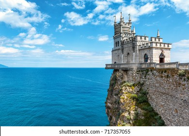 Castle Swallow's Nest on a rock over Black Sea, Crimea, Russia. This amazing castle is a symbol and landmark of Crimea. Beautiful view of Swallow's Nest on the blue sky background with copy space.