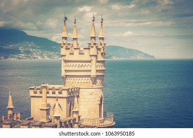 Castle Swallow's Nest over the Black Sea in Crimea, Russia. Swallow's Nest is famous landmark and symbol of Crimea. Vintage photo of Swallow's Nest castle.