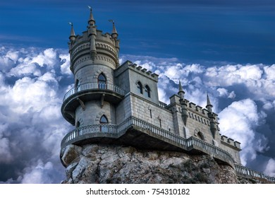 The castle Swallow's nest. The village of Gaspra on the Crimean background of the cloudy sky, Top of the 40-metre (130 ft) high Aurora Cliff, in a Neo-Gothic design.