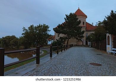 The castle of Telc and the gate to the main square of Telc. Famous touristic place and travel destination in Europe. Summer morning view. Telc, Czech Republic.