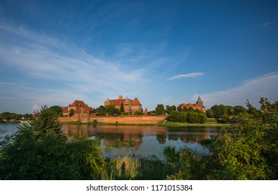 castle of the Teutonic Order Malbork (Marienburg) on the river bank in Poland