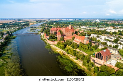 The Castle of the Teutonic Order in Malbork on the bank of the Nogat River. UNESCO world heritage in Poland