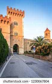 castle with tower and city gate of Bolgheri, in Tuscany, Italy