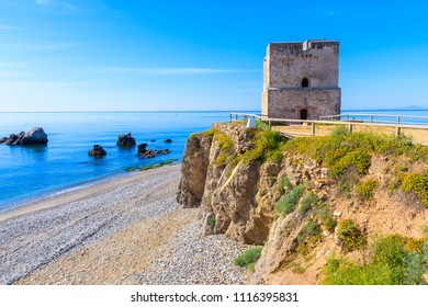 Castle tower on beach near Estepona town on Costa del Sol, Spain
