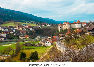 Castle from a town in Slovenija surrounded by mountains