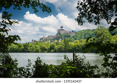 A castle Trencin with a city and a river Vah
