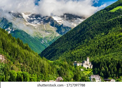 Castle of Tures and peaks of Selva dei Molini. Dream South Tyrol. Roma refuge. Italy.