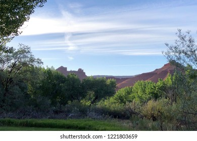 Castle Valley near Moab, UT - June 11, 2018: A panoramic view of the Castle Valley landscape taken near Moab. Blue skies and a few wispy clouds seen in this photo accentuate the beauty of the region.