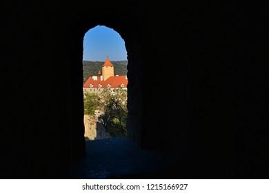 Castle Veveri - City of Brno, Czech Republic - Europe. Beautiful autumn landscape with castle. Brno dam and sunset at the golden hour. Autumn season October.