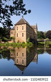 Castle Vorden in the Achterhoek reflecting in its moat