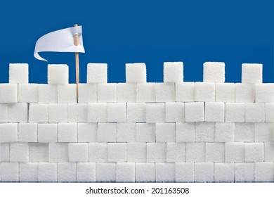 A castle wall made of sugar cubes with a white flag of truce.