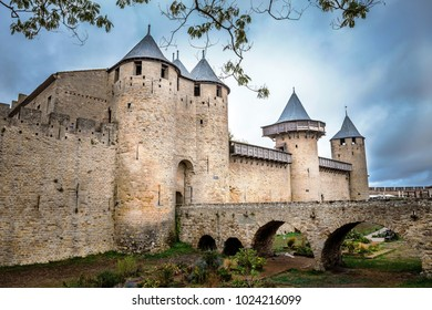 Castle walls of Carcassonne fortress in France with crowd clouds on the background.