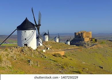 Castle and windmills at Consuegra, Toledo region, Castilla La Mancha, Spain. Route of Don Quixote with windmills.