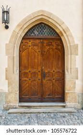 castle wooden door with a lantern