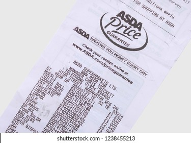 Castleford, UK - April 17th, 2015: Asda supermarket printed till receipt shot flat from above. The company was founded in 1949 and has their headquarters in Leeds West Yorkshire