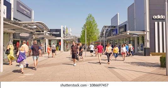CASTLEFORD, UK - MAY 7 2018: Shoppers enjoying Spring Bank Holiday at the Outlet Village, Junction 32, Castleford, West Yorkshire, UK