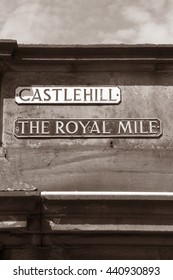 Castlehill and the Royal Mile Street Signs, Edinburgh, Scotland in Black and White Sepia Tone