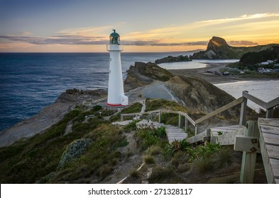Castlepoint Lighthouse lookout over the small bay that fishing boats go out. New Zealand