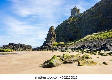 CASTLEROCK, NORTHERN IRELAND - May 1, 2015: The iconic Mussenden Temple on top of the cliffs of Downhill Beach. Castlerock, Derry County, Northern Ireland