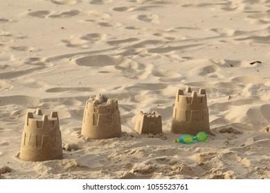 Castles on the sand at the end of a day at the beach
