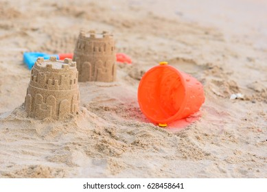 Castles sand and toy on sand beach.