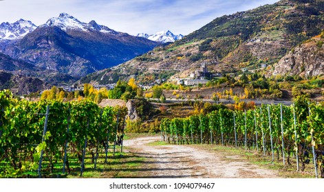 Castles and wineyards of Valle d'Aosta with scenic Alps mountains. Italy