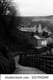 Castleton, Derbyshire / UK - 01/23/18: Footpath alongside Peakshole Water river, leading from Peak Cavern (known as the 'Devil's Arse') to Castleton.