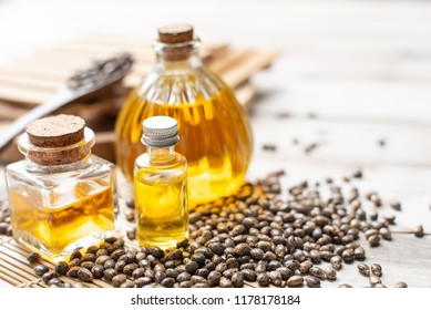 Castor oil in bottles on wooden background