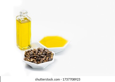 castor oil and grains in bowl isolated on white background image close-up