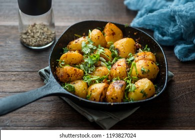 Castor potatoes in a cast iron skillet