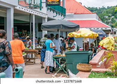 CASTRIES, ST LUCIA - JUNE 09 2007: Shoppers browsing the exotic fruit and vegetables at the tropical street markets in Castries, St Lucia. These agricultural markets are a major supplier of fresh pro