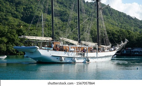 Castries / St Lucia - November 2016; Marigot Bay marina with boats and yachts surrounded by lush green jungle forest landscape on Saint Lucia Island in the Caribbean.