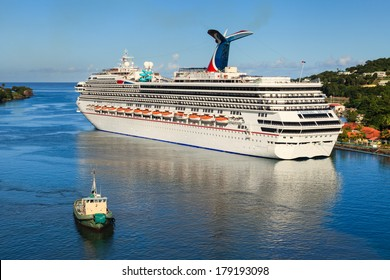 CASTRIES, ST LUCIA - NOVEMBER 7: Cruise ship Carnival Valor docked in Castries on November 7, 2013. The Valor operated by Carnival Cruises whose maiden voyage was in 2004 was built at a cost of $500m.