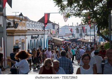 CASTRO MARIM, PORTUGAL - AUGUST 25, 2017: View of people, characters, mood, colors and street performers at the popular medieval fair held in Castro Marim, Portugal.