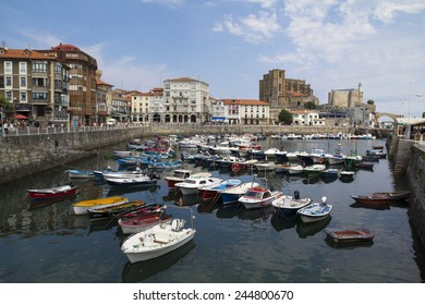 CASTRO URDIALES, SPAIN - AUGUST 16, 2013: Local harbor in the north of Spain, with many colorful boats at the town of Castro Urdiales in August 16, 2013 in Spain