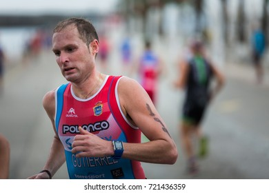 CASTRO URDIALES, SPAIN - AUGUST 27, 2017: Unidentified athlete in the running competition during the XXIX Triathlon of Castro Urdiales